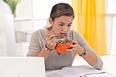Student eating cereal