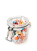 Assorted pills in a jar