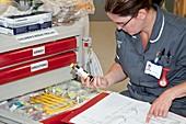 Nurse checking resuscitation supplies