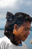 Man with pet monkey in Indonesia