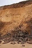 Landslip revealing sewer pipe,Happisburg
