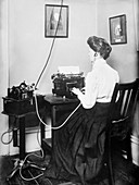 Blind stenographer using dictaphone,1911