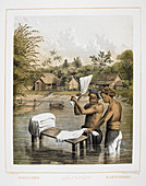 Two men washing laundry in a river