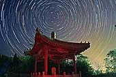 Polar star trails over pagoda
