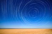 Polar star trails over a beach