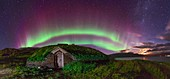 Auroral over Viking house,Greenland