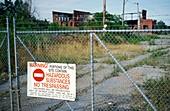 Warning sign at a disused factory