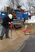 Worker repairing water mains