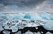 Glacial ice on volcanic beach,Iceland