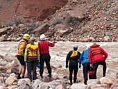 Rafters scouting rapids,Grand Canyon