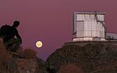 Moonrise behind the NTT telescope,Chile