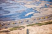 Dump trucks at tar sand mine
