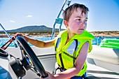 Boy driving a speedboat