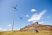 Wind turbines beneath An Sgurr,Eigg,UK