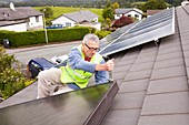 Workman fitting solar thermal panels