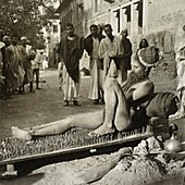Fakir on his bed of spikes,1900s