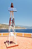 Solar-powered harbour light,Greece