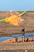 Gas flare at an oil field