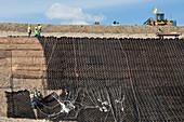 Workers stabilising a hillside