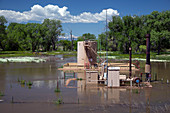 Oil well flooded by river,USA