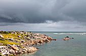 Storm over rocky coastline