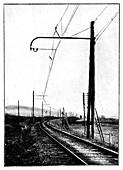 Overhead train power lines,19th century