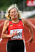 Senior athlete runs through the pain