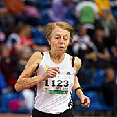 Elderly female athlete in competition