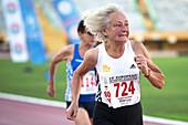 Silver-haired female athlete running