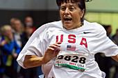 Joyful older female athlete running