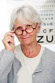 Elderly woman wearing glasses