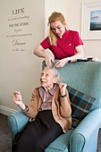 Elderly woman with carer