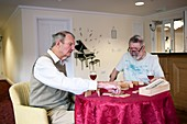 Elderly men playing dominoes