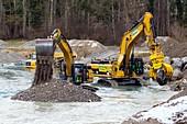 Excavators in Thur river