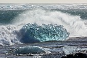 Blue iceberg and wave