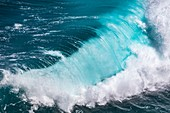 Breaking wave and blue sea