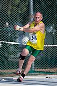 Senior athlete prepares hammer throw