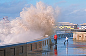 People dodging storm waves