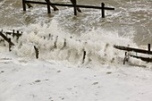 Waves crashing against the sea defences