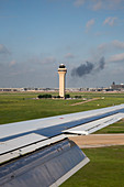 Airport control tower and airplane wing