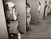 Women taking hearing tests,c 1939