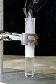 Phosphorus chloride reacting with acid