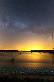 Milky Way over bioluminescent plankton