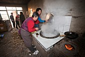A Chinese family cooks on a stove