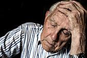 Tired elderly man