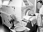 Patient in fever machine,1940s