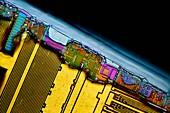 Damaged computer RAM module,micrograph