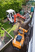 A mini digger and mini dumper truck