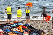 Volunteers helping refugees,Greece