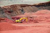 Excavating volcanic Scoria rock